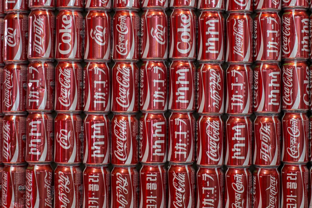 A wall of cans of Coca-Cola, with the brand written in different languages, is displayed in the FIFA Fan Fest on June 23, 2014, in Belo Horizonte, Brazil.