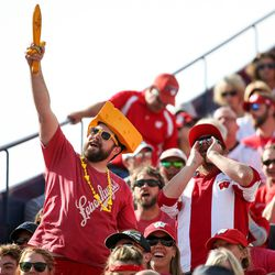 """Wisconsin Badgers fans cheer """"we want more beer"""" during the game against the Brigham Young University Cougars at LaVell Edwards Stadium in Provo on Saturday, Sept. 16, 2017."""