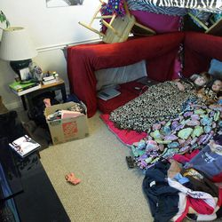 BYU student Kelsey Morasco watches TV in their front room fort with roommates Ashley Mauger, Lindsey Hunt and Breanna Hutchings in their apartment in Provo April 29, 2012.