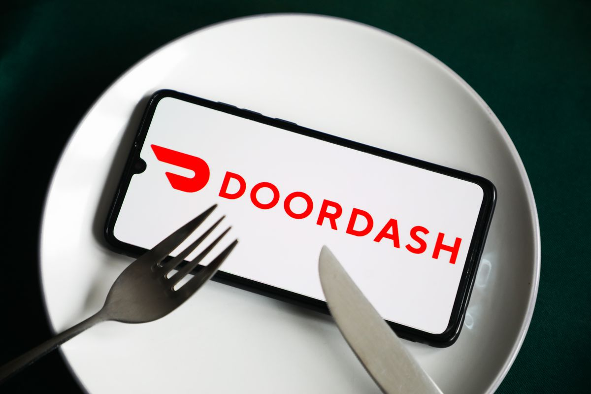 A phone with the Doordash logo on a plate