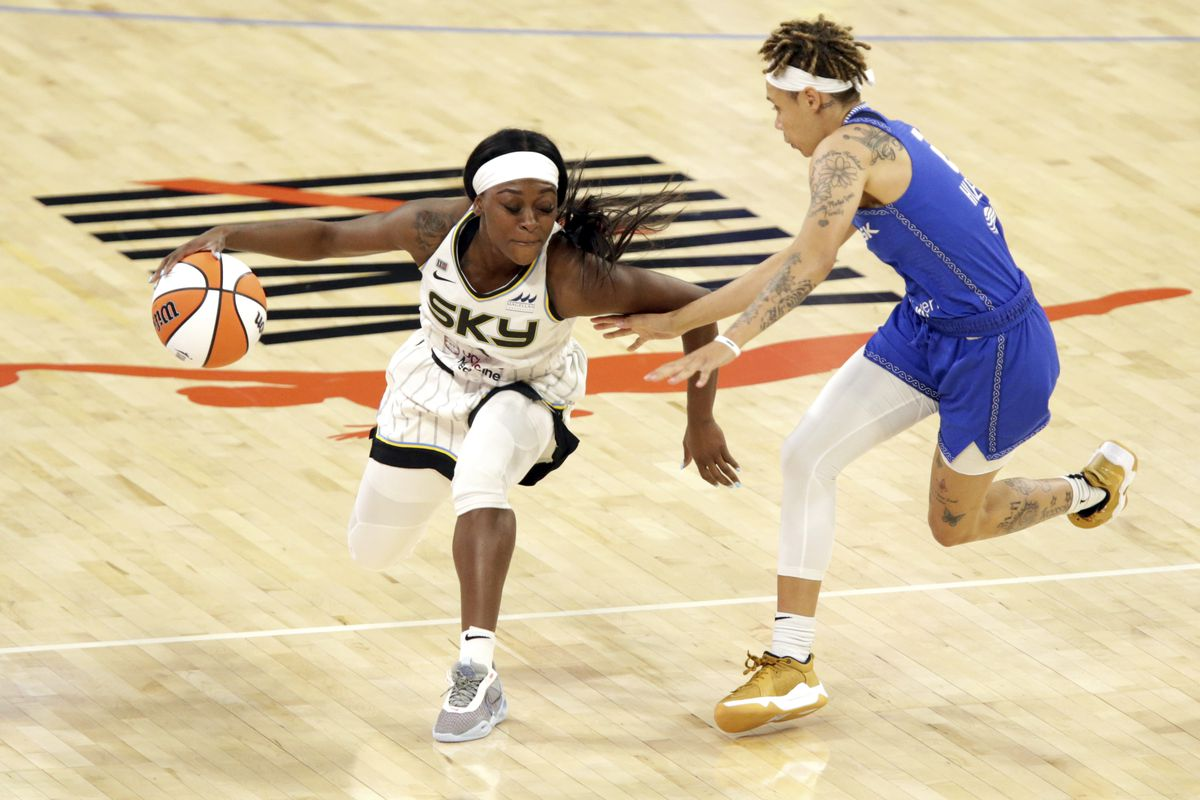 Chicago Sky guard Dana Evans, left, protects the ball from Connecticut Sun guard Natisha Hiedeman during a WNBA game Saturday, June 19, 2021 in Chicago. (AP Photo/Eileen T. Meslar) ORG XMIT: NYOTK