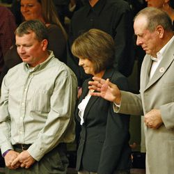 Douglas Brian Fox, left, and Cindy and Russell Greathouse, the widower and parents of slain Millard County sheriff's deputy Josie Greathouse Fox, are recognized as Utah Gov. Gary Herbert gives his first State of the State speech in the Utah State Capitol Jan. 26, 2010, in Salt Lake City.