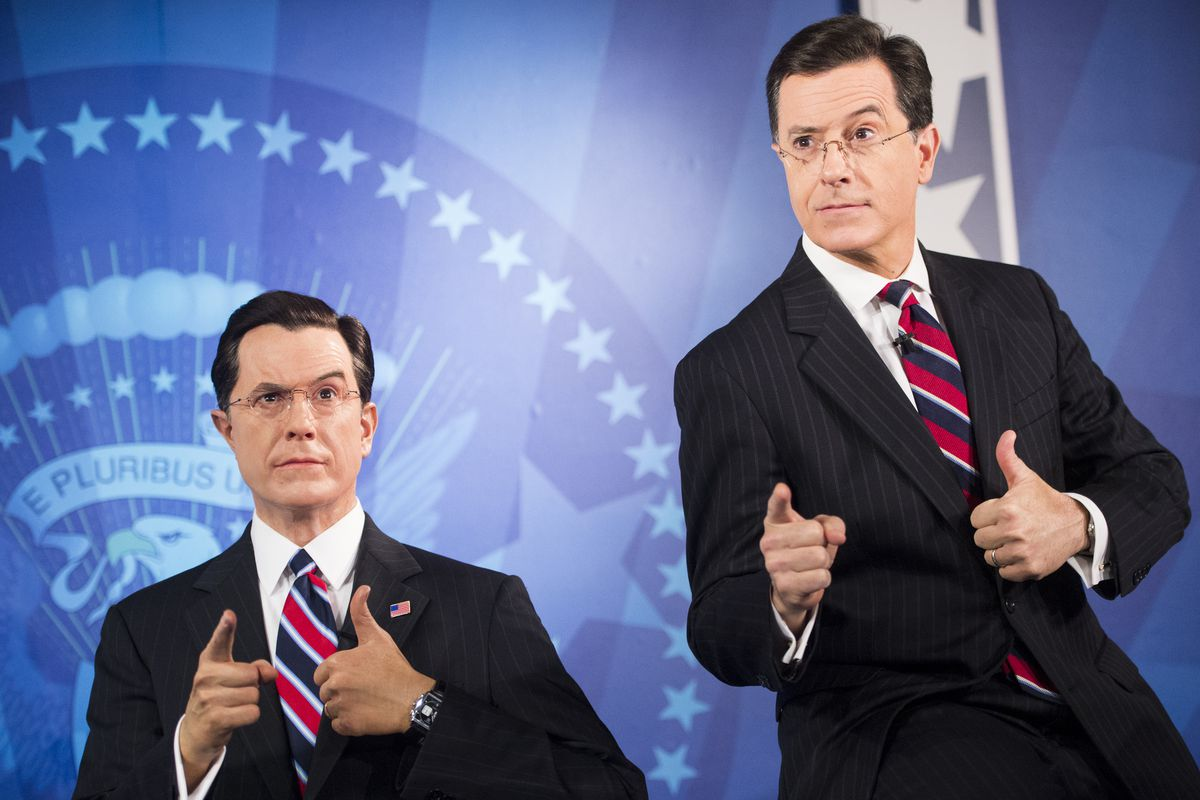 Colbert poses with himself during the unveiling of his wax figure at the Madame Tussauds wax museum in Washington on Friday, Nov. 16, 2012.