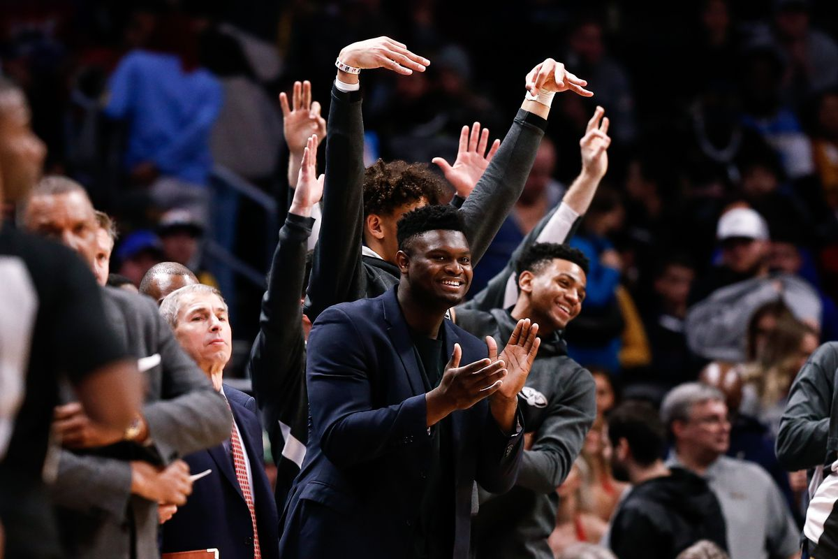 New Orleans Pelicans forward Zion Williamson reacts with teammates from the bench in the fourth quarter against the Denver Nuggets at the Pepsi Center.