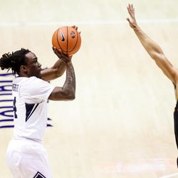 Brigham Young Cougars guard Brandon Averette (4) shoots over Pacific Tigers guard Pierre Crockrell II (3) at the Marriott Center in Provo on Saturday, Jan. 30, 2021.