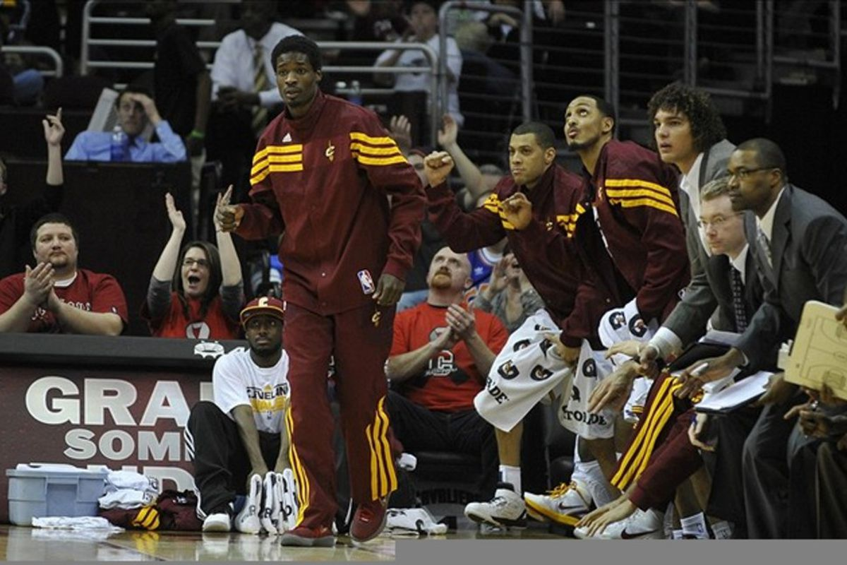 Feb 28, 2012; Cleveland, OH, USA; Cleveland Cavaliers guard Manny Harris (left) and players on the bench celebrate a score in the third quarter against the Houston Rockets at Quicken Loans Arena. Mandatory Credit: David Richard-US PRESSWIRE