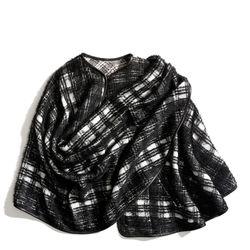 "<a href=""http://f.curbed.cc/f/Coach_SP_102413_PlaidCape"">Black and white plaid wrap cape</a>, $698"