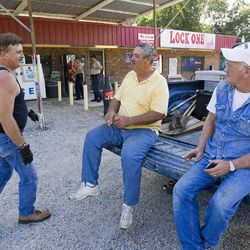 Buddy Davis, left, James Moorman and Carl Crawford shoot the breeze at the Lock One Pantry north of Pearl River after an evacuation was ordered after Lock 2 became in danger of failing Saturday, September 1, 2012, on the Pearl River navigational canal in St. Tammy Parish, La..