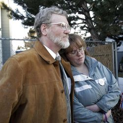 Kiirsi Hellewell, friend of Susan Powell, hugs her father as she talks about the Powell family in Salt Lake County  Sunday, Feb. 5, 2012. Josh Powell and his two sons were killed in an explosion in Washington.
