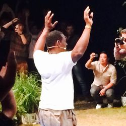 """Ron Finley leads a """"hands up, don't shoot"""" group photo"""