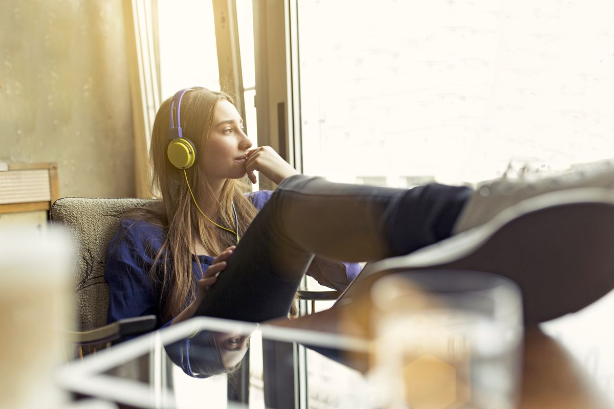 Woman with headphones relaxing