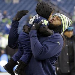 """Seattle Seahawks fullback Will Tukuafu (East High) holds his daughter Kaiya before an NFL divisional playoff football game against the Carolina Panthers in Seattle, Saturday, Jan. 10, 2015.  <img src=""""http://beacon.deseretconnect.com/beacon.gif?cid=243096&pid=7"""" />"""