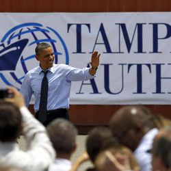 President Obama waves as he arrives to speak at the Port of Tampa in Tampa, Fla., Friday April 13, 2012.