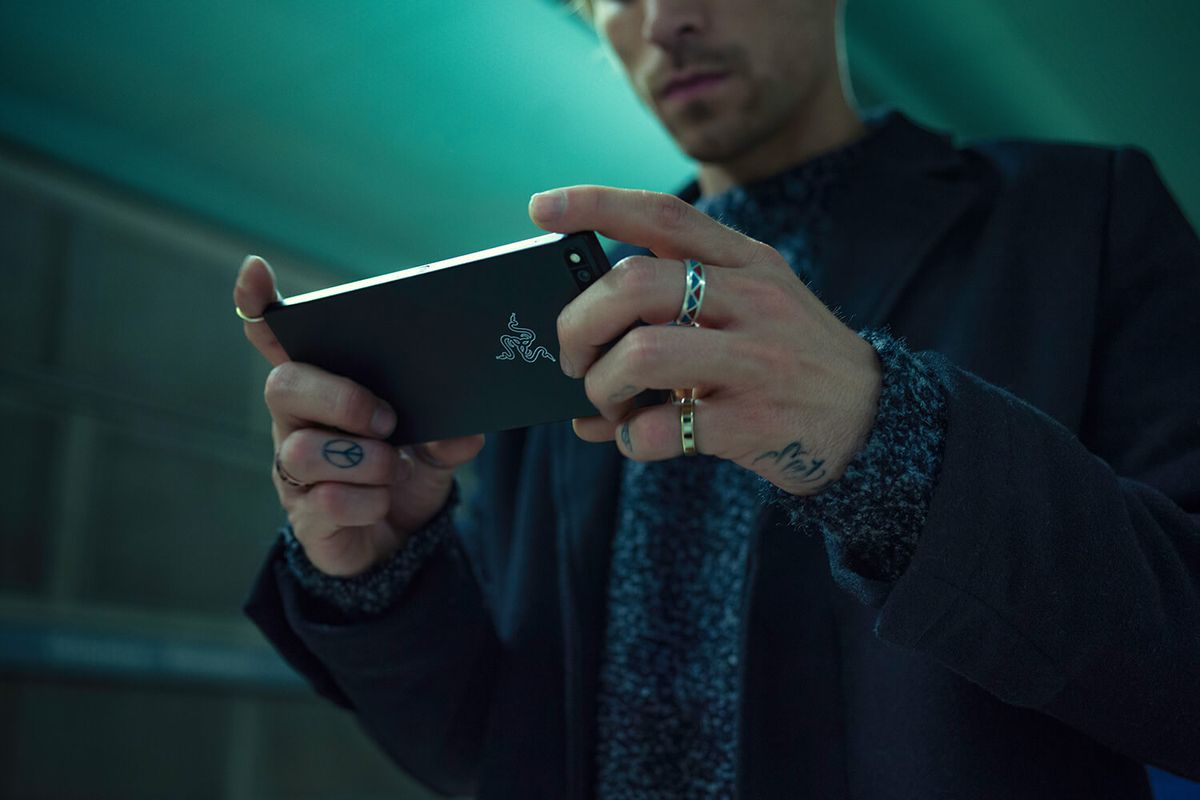 a man holding a Razer smartphone in his hands