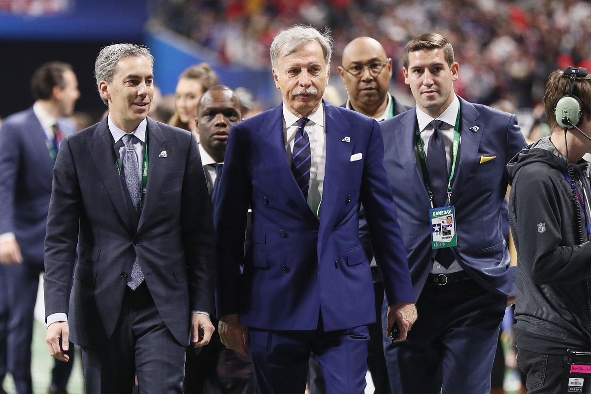 Los Angeles Rams Owner Stan Kroenke walks with Chief Operating Officer and Executive Vice President of Football Operations Kevin Demoff and Vice President of Football and Business Administration Tony Pastoors prior to Super Bowl LIII, Feb. 3, 2019.