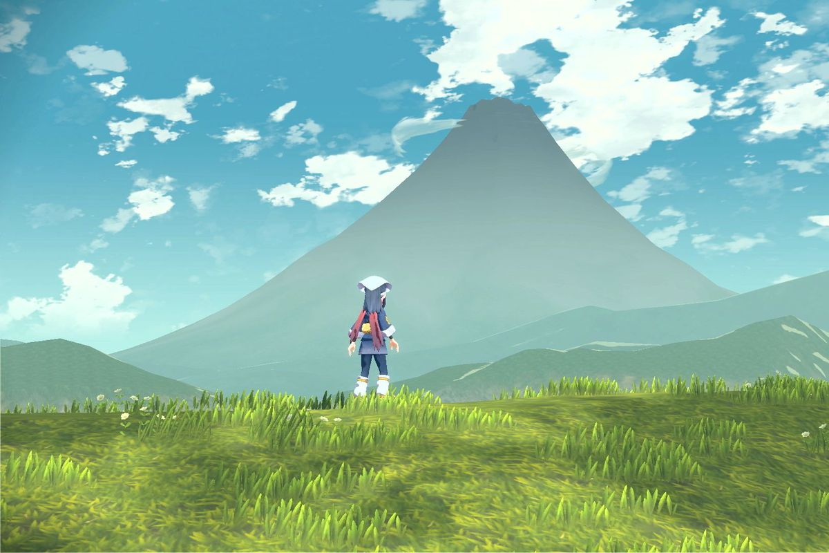 A Pokémon trainer staring off at a distant mountain.