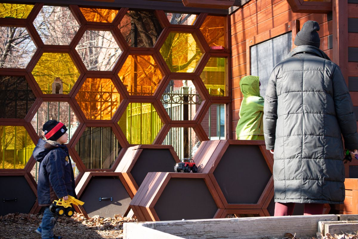 A family stops at The Hive at El Paseo Community Garden in Pilsen.