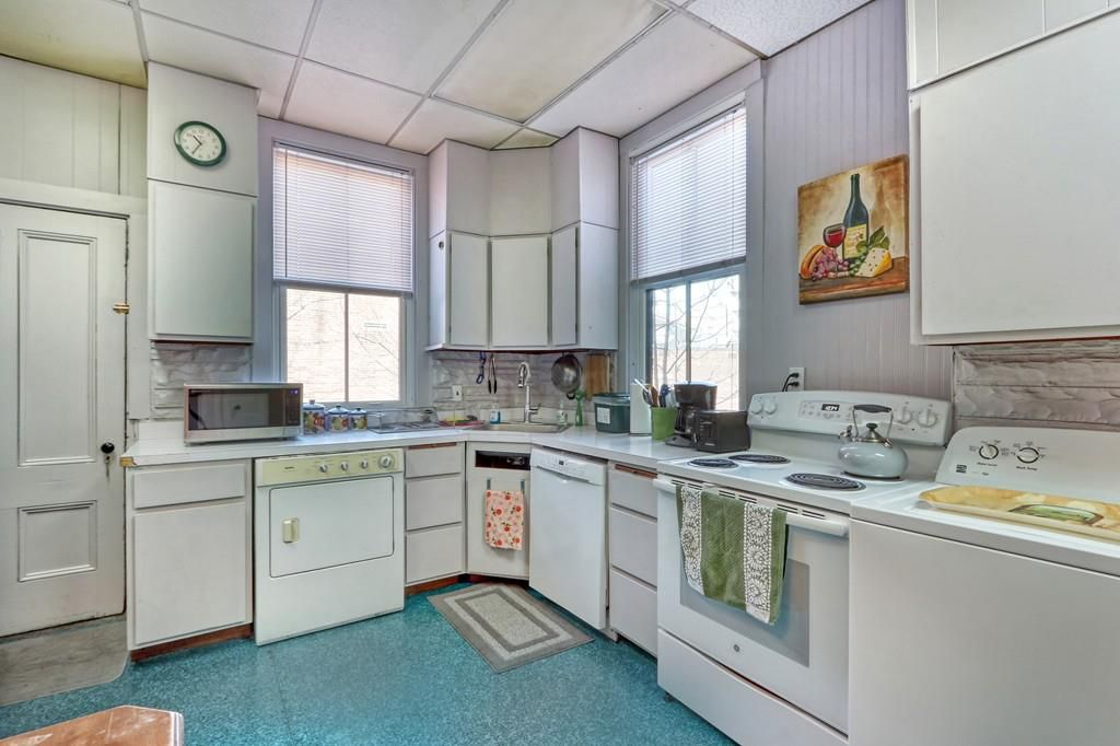 An older, classic-looking kitchen with an L-shaped counter.
