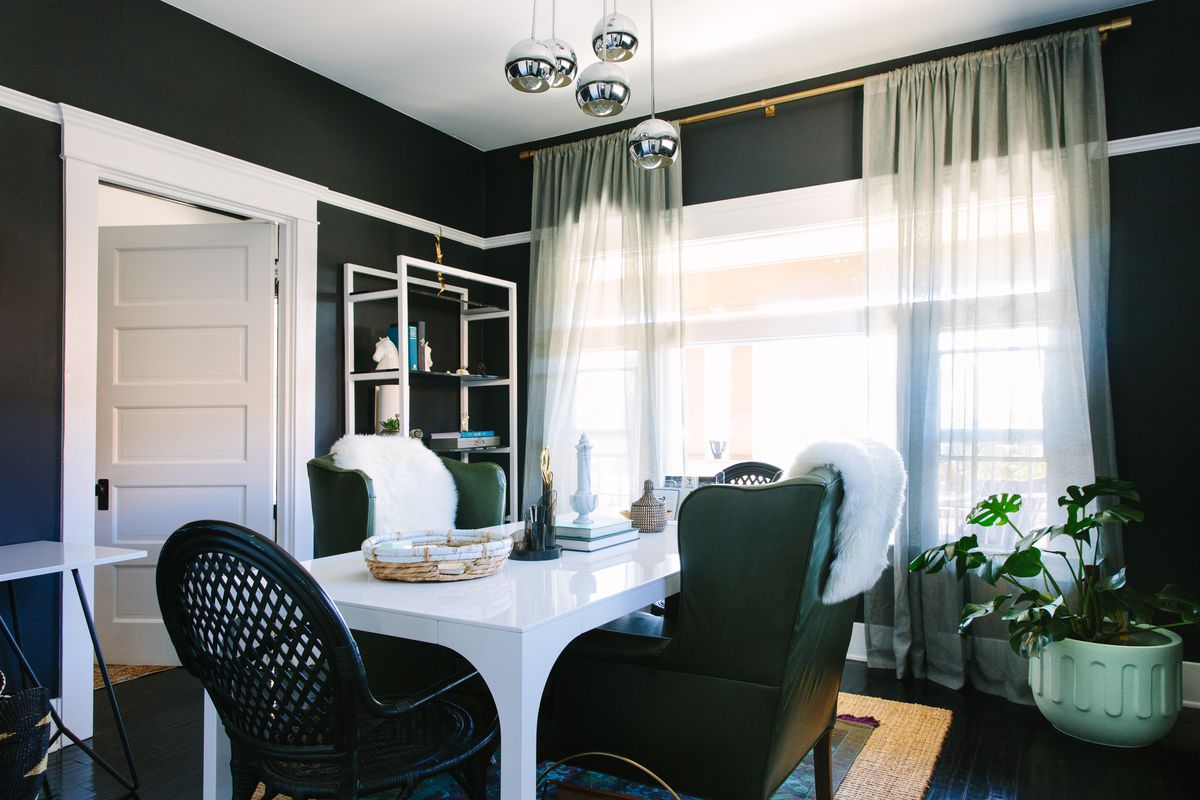 An off-black dining room.