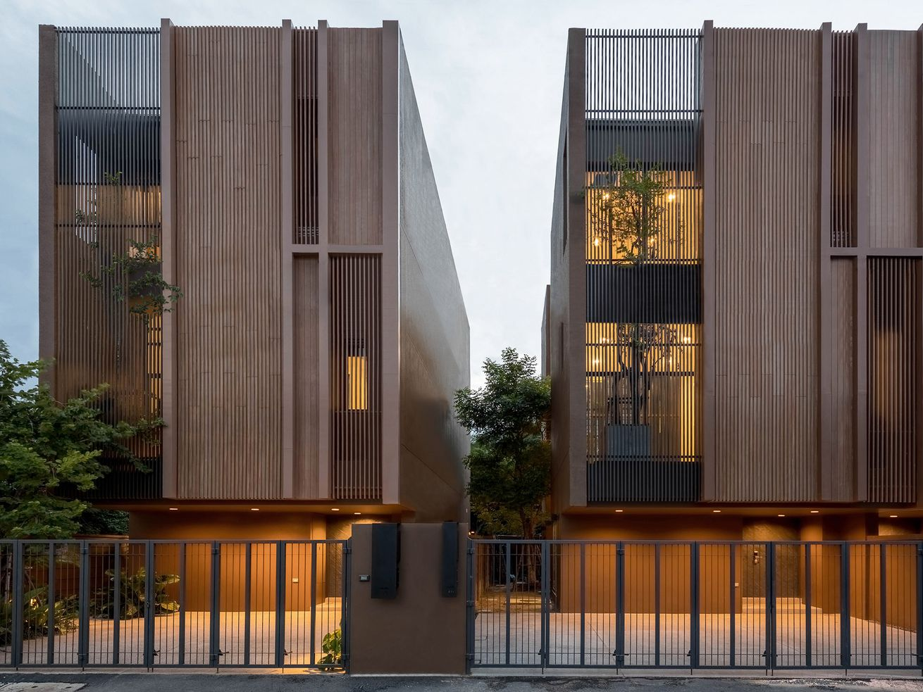 Breezy luxury townhouses have greenery poking out all over