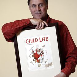 """Don Trachte of Bennington, Vt., poses with a 1953 Child Life magazine cover illustration """"Santa's Helpers"""" by Norman Rockwell for which he modeled, at the Bennington Museum on Friday, Sept. 28, 2012, in Bennington, Vt. Trachte is the child on the left.  (AP Photo/Mike Groll)"""