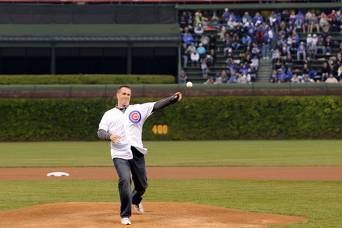 Northwestern football coach Pat Fitzgerald throws a ceremonial pitch at Wrigley Field, May 7, 2012.