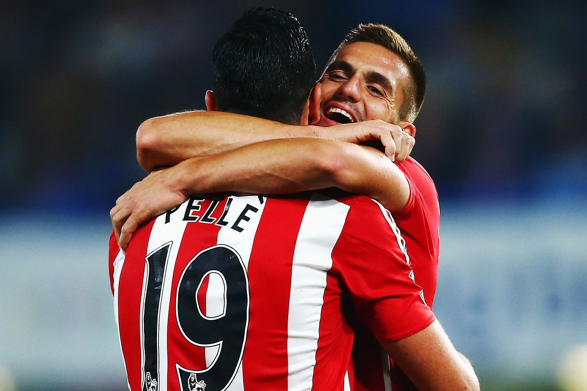 Graziano Pellé and Dušan Tadić embrace as they play their part in an impressive Saints display