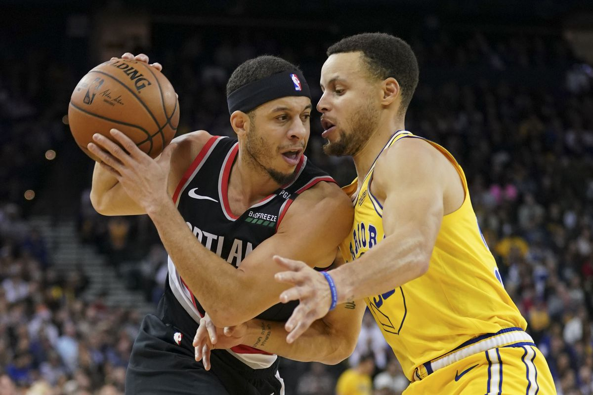 1dbf7438adc1 Warriors Steph Curry takes on Blazers Seth Curry in three-point ...