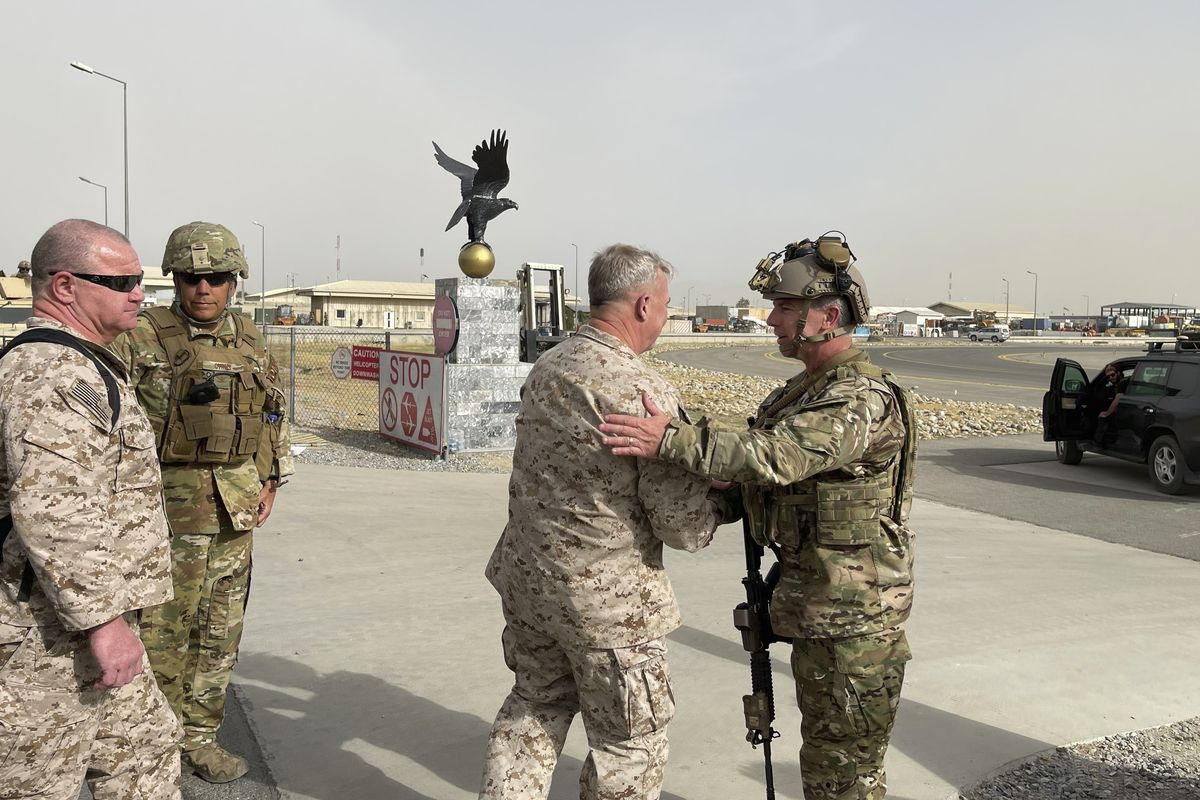 U.S. Marine Corps Gen. Frank McKenzie, center, the commander of U.S. Central Command, meets with U.S. Navy Rear Adm. Peter Vasely, commander of U.S. Forces Afghanistan-Forward, at Hamid Karzai International Airport in Kabul, Afghanistan last week.