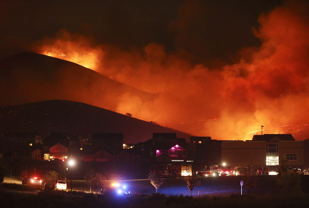A wildfire on Traverse Mountain threatens homes in Lehi in2020.