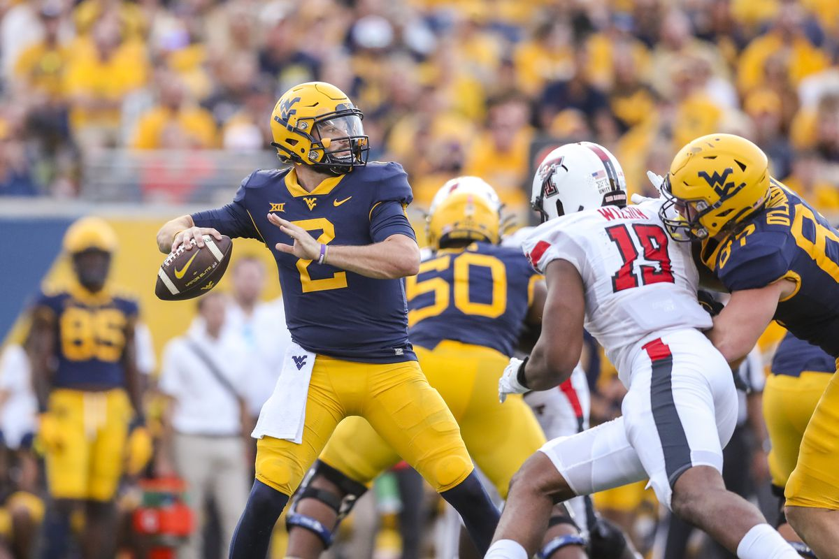 West Virginia Mountaineers quarterback Jarret Doege (2) passes the ball during the fourth quarter against the Texas Tech Red Raiders at Mountaineer Field at Milan Puskar Stadium.
