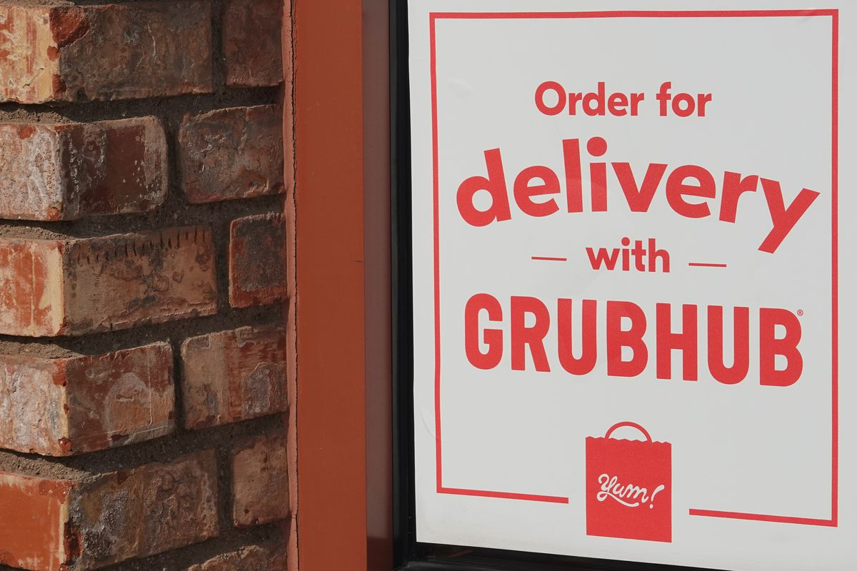 Sign for Grubhub delivery on a restaurant window
