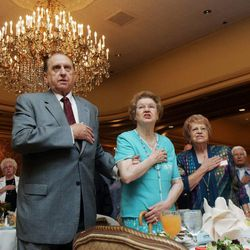 From left, Thomas S. Monson of the first presidency of the Church of Jesus Christ of Latter-day Saints recites the Pledge of Allegiance with his wife Frances (cq'ed) and Bonnie Hunsaker Shoemaker at the West High class reunion for classes '42-'44 at the Little America in Salt Lake City Saturday, September 15, 2007.