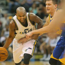 Utah's John Lucas III pushes hard around Warriors' Nemanja Nedovic as the Utah Jazz and the Golden State Warriors play Tuesday, Oct. 8, 2013 in preseason action at EnergySolutions arena in Salt Lake City. Lucas III has played all over the globe during his basketball career.