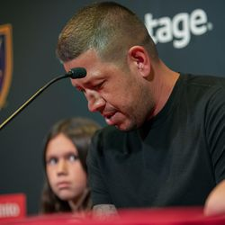 Real Salt Lake's goalkeeper Nick Rimando becomes emotional while talking as he is joined by his kids, Benny Rose Rimando and Jett Nicholas Rimando, at a press conference at Rio Tinto Stadium in Sandy on Friday, Sept. 27, 2019. Rimando will play his last home game on Sunday.
