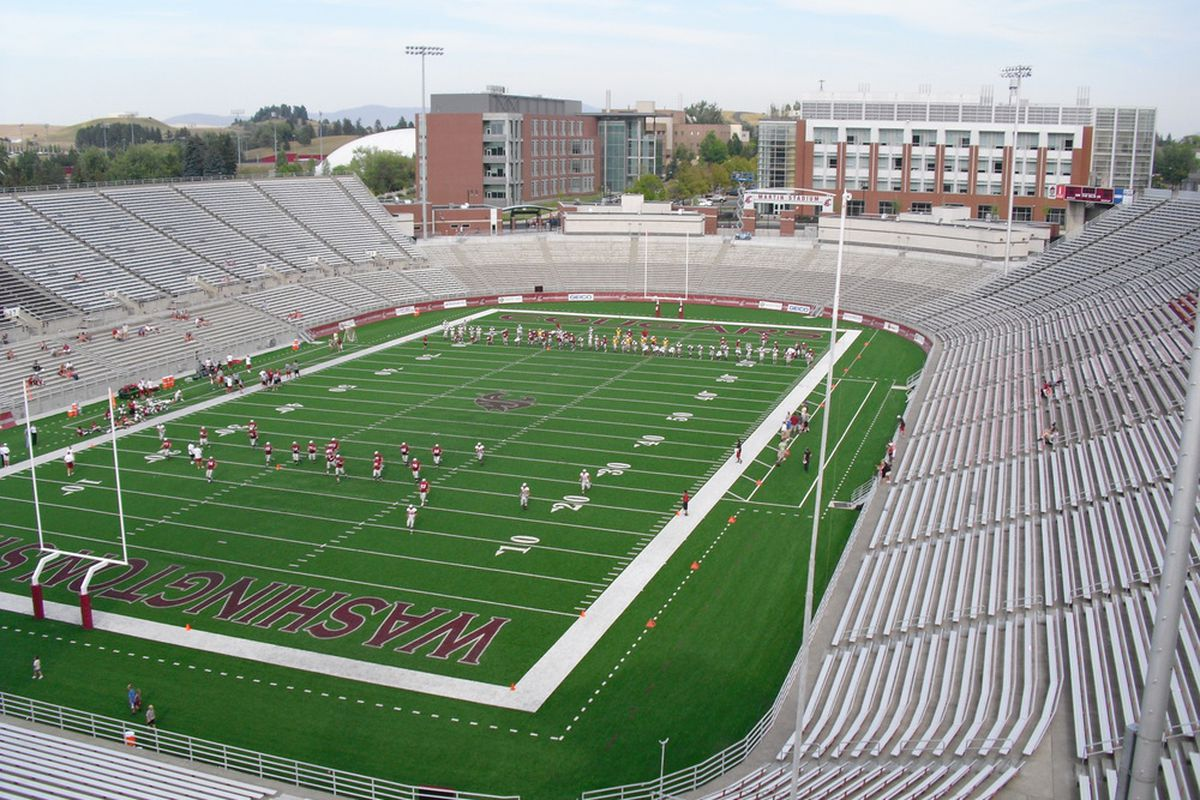 Martin Stadium, with the team running sprints after the scrimmage