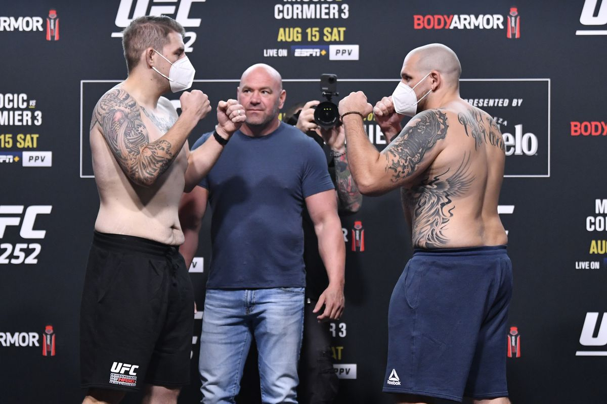 Opponents Chris Daukaus and Parker Porter face off during the UFC 252 weigh-in at UFC APEX on August 14, 2020 in Las Vegas, Nevada.