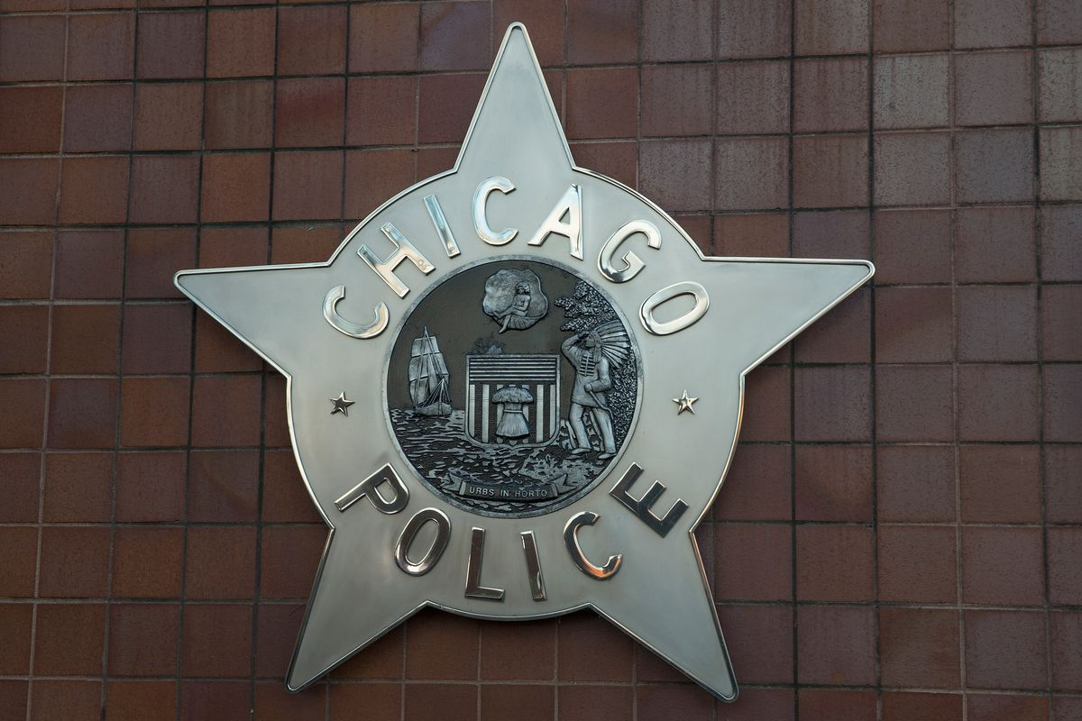 A Chicago police badge hangs in front of the City of Chicago Public Safety Headquarters.