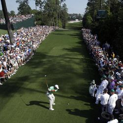 Tiger Woods tees off on the 18th hole during a practice round for the Masters golf tournament Wednesday, April 4, 2012, in Augusta, Ga.