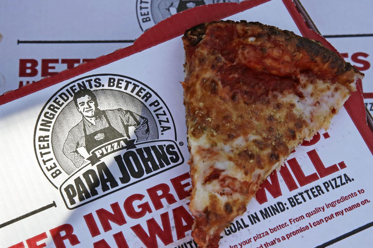 This Dec. 21, 2017, file photo shows a slice of cheese pizza at the Papa John's pizza shop in Quincy, Mass. Papa John's plans to pull Schnatter's image from marketing materials following use of racial slur. Schnatter apologized Wednesday, July 11, and sai