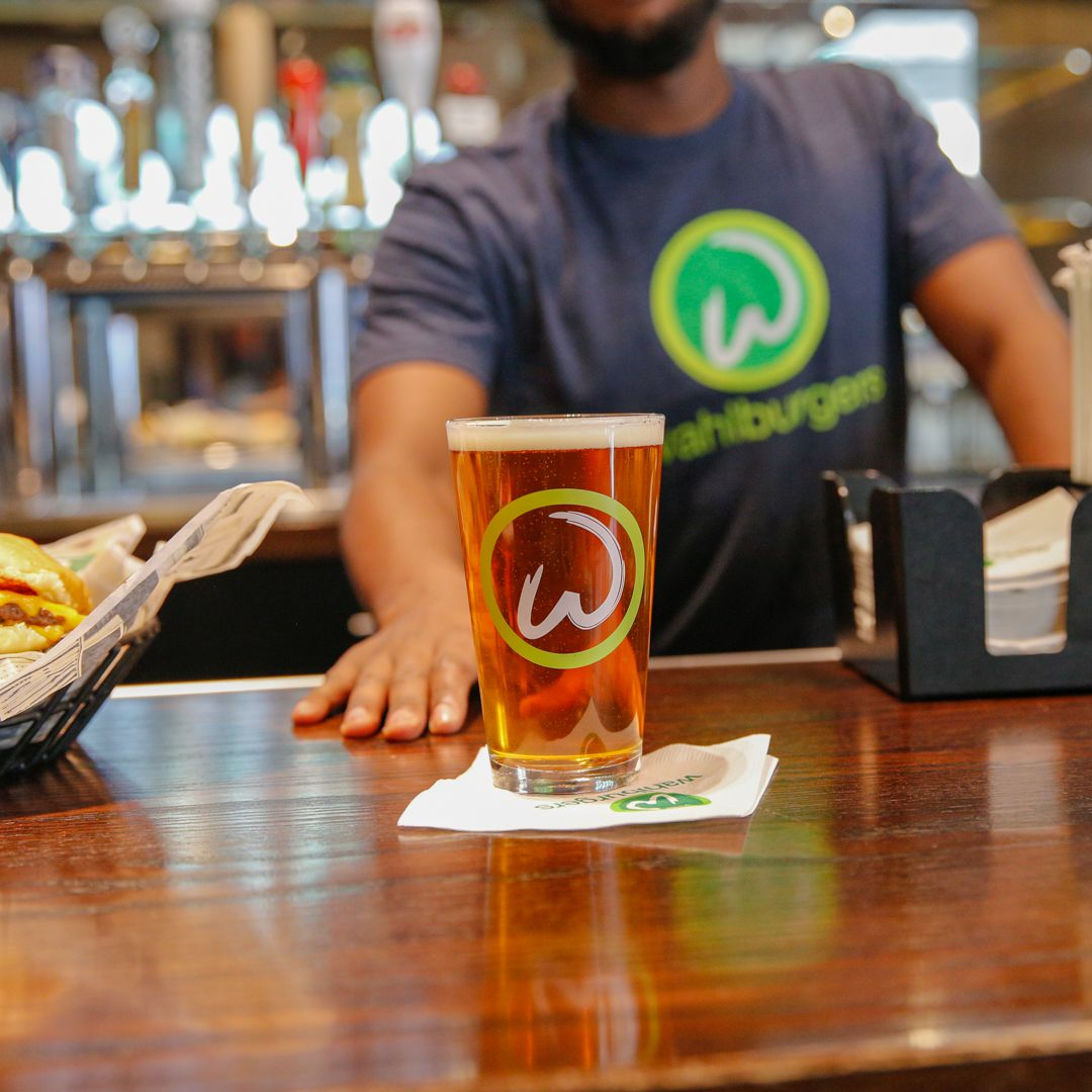 The famous Wahlbrewski beer is among the drink and cocktails options at Wahlburgers. | Courtesy Wahlburgers