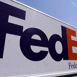 FILE-In this Wednesday, May 16, 2012, file photo, a FedEx delivery truck is seen at the Illinois State Capitol in Springfield, Ill. FedEx Corp. says the global economy is worsening and it's cutting its forecast for the fiscal year ending in May. The world's second largest package delivery company says profit in the current quarter will be well below year ago results.