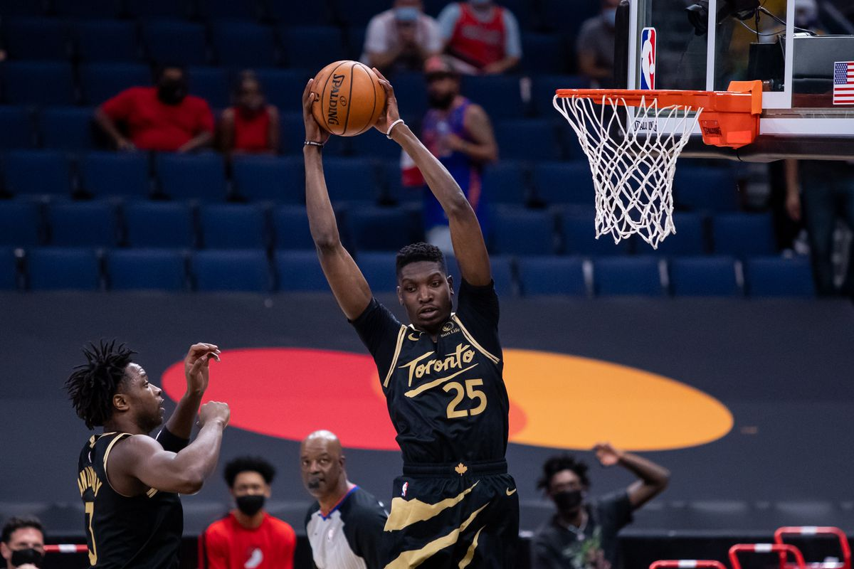 Toronto Raptors forward Chris Boucher rebounds a ball against the Portland Trail Blazers during the first quarter at Amalie Arena.