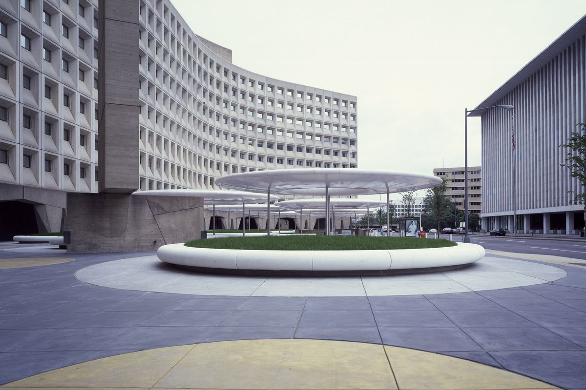 The headquarters of the Department of Housing and Urban Development, a brutalist building with circular canopies in its plaza.