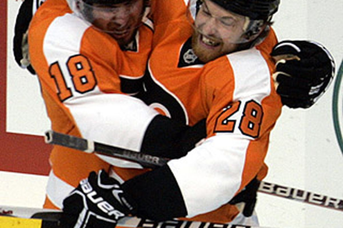 Mike Richards and Claude Giroux celebrate after Richards scored a highlight-reel shorthanded goal in Monday's 4-2 series clinching win.