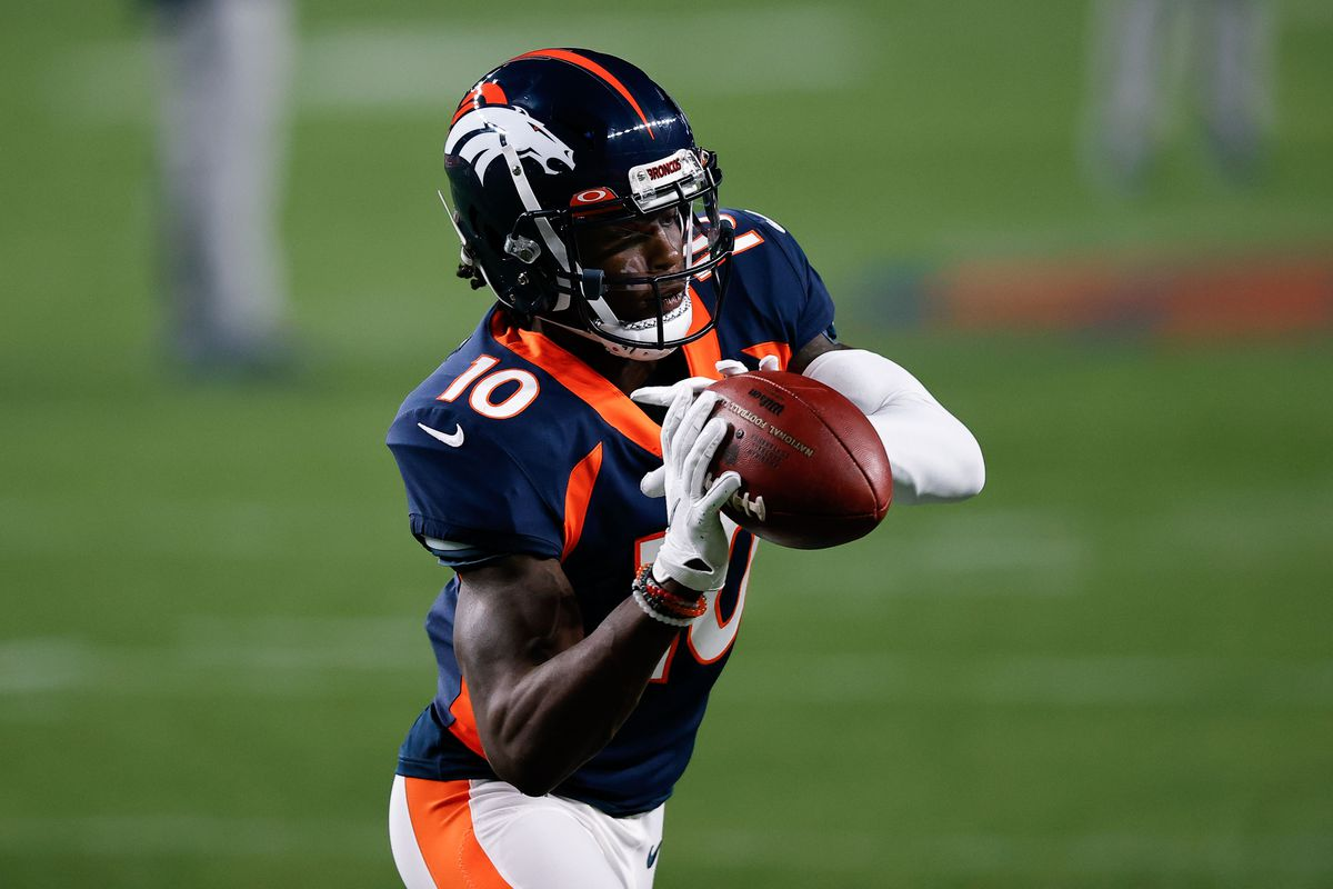 Broncos wide receiver Jerry Jeudy (10) warms up before the game against the Tennessee Titans at Empower Field at Mile High.