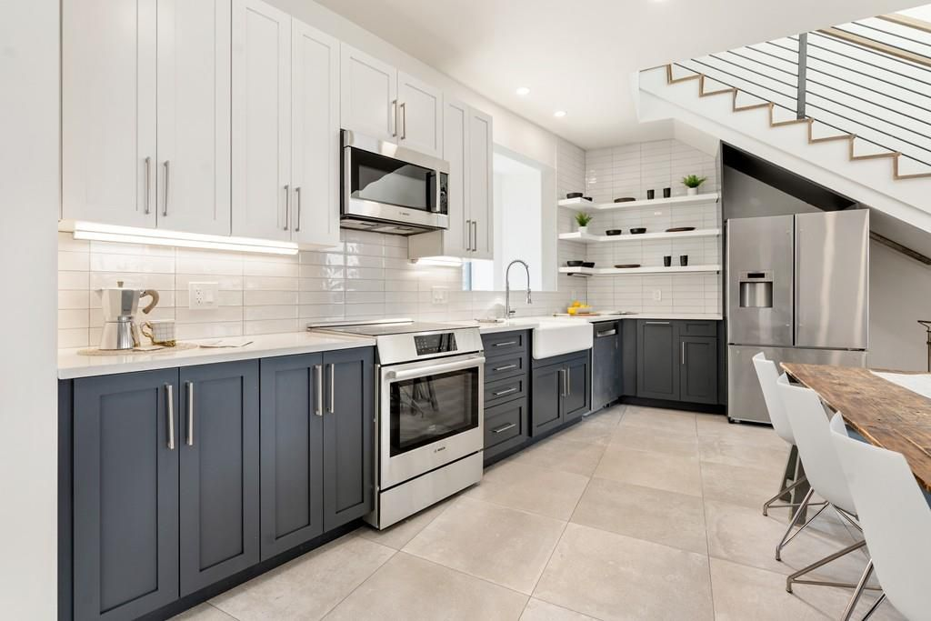 An open kitchen with a long L-shaped counter.