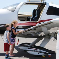 Kenner and Trinelle Hardinger look inside a Cessna TTX plane during the Skypark Aviation Festival and Expo at Skypark Airport in Woods Cross on Friday, June 2, 2017. The expo is Utah's largest annual aviation event.
