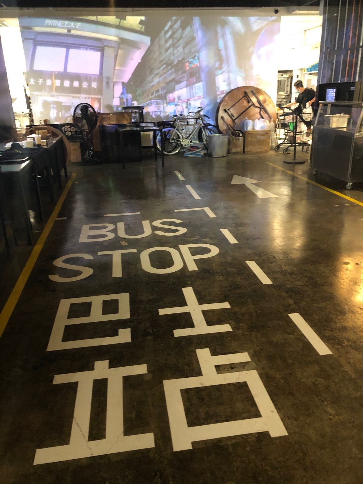 """""""Bus stop"""" markings  painted on the floor of the dining"""