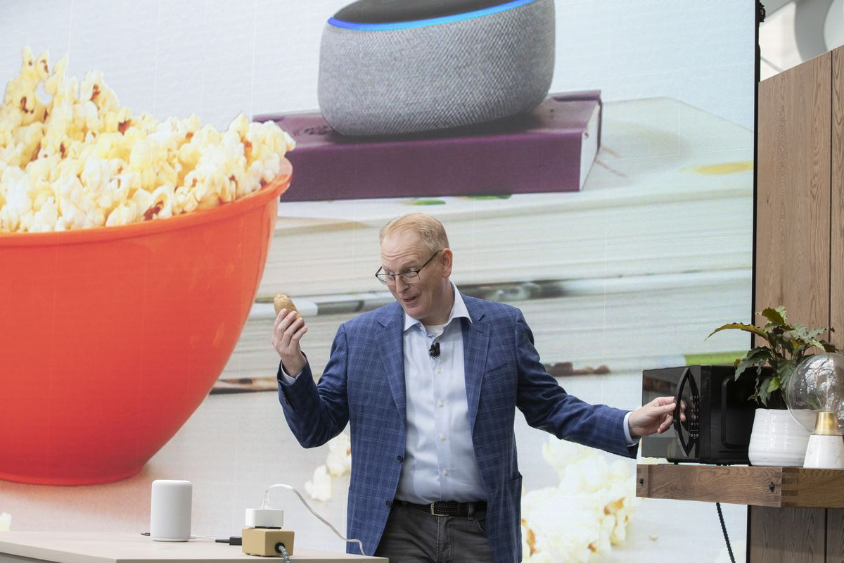 Dave Limp, senior vice president of Amazon Devices, demonstrates the Amazon Basics Microwave, which can be voice-controlled by an Alexa device.